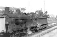 McIntosh 3F 0-6-0 no 57622 poses with a cheery Polmadie crew at Giffnock in 1960. <br><br>[David Stewart&nbsp;//1960]