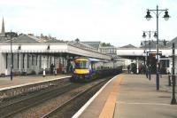 The 09:34 service to Dundee draws into platform 2 at the well preserved Stirling station on 1 September 2014.<br><br>[Colin McDonald&nbsp;01/09/2014]
