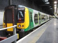 London Midland EMU 350267 about to leave platform 18 at Euston on 29 August 2014. The heavily loaded twelve coach train, running slightly late, is the 18.13 service to Birmingham New Street via Northampton.<br><br>[David Pesterfield&nbsp;29/08/2014]