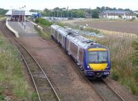 170423 leaves Leuchars on 2 September 2014 with the 11.34 Dundee - Edinburgh.<br><br>[Bill Roberton&nbsp;02/09/2014]
