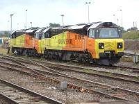 Colas Rail 70805 and 70809 stabled at Westbury during the late morning of 29 August 2014. Photographed looking west from the station platform.<br><br>[David Pesterfield&nbsp;29/08/2014]