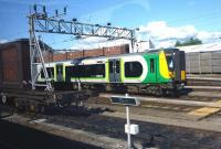 View from a passing train as a London Midland service departs from Crewe on 23 August 2014, about to run past an interesting item of equipment in the foreground(?).<br><br>[John Steven&nbsp;23/08/2014]