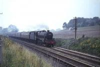Black 5 no 45359 photographed heading towards Cumbernauld on 4 August 1965 with a Glasgow - Dunblane train.<br><br>[G W Robin&nbsp;03/08/1965]