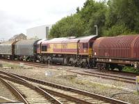 DBS 66129 performing a push-pull operation alongside Swindon platform 1 on 29 August in order to extract empty steel wagons from the nearby Hawksworth steel terminal, seen in the distance, for transfer to the yard beyond the east end of the station. <br><br>[David Pesterfield&nbsp;29/08/2014]