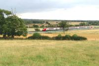 A Virgin Voyager forming the 1510 London Euston - Chester speeds through the Northamptonshire countryside near Bugbrooke on 21 August heading for its penultimate stop at Crewe.<br><br>[John Steven&nbsp;21/08/2014]