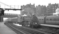 BR Standard class 5 4-6-0 no 73075 runs into the north end of Carlisle on 3 August 1963 with the summer Saturday 1.57pm Gourock - Birmingham New Street. The Polmadie locomotive will hand over to a Holbeck <I>Jubilee</I> for the next leg of the journey south as far as Leeds [see image 47420].<br><br>[K A Gray&nbsp;03/08/1963]