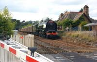 Stanier pacific no. 46233 <I>Duchess of Sutherland</I> with the southbound <I>Cumbrian Mountain Express</I> on 6 September 2014 passing Culgaith, with the residents of the former station enjoying the spectacle from the adjacent fence.<br><br>[John McIntyre&nbsp;06/09/2014]