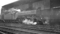 The coaling stage at Heaton shed on 25 May 1963, with locally based A3 Pacific 60073 <I>'St Gatien'</I> alongside.<br><br>[K A Gray&nbsp;25/05/1963]