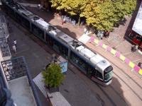 Hotel balcony view of Grenoble Alstom Citadis Tram 6025 of the TAG fleet, on a Line B service, negotiating the tramworks in Place Grenette on 5 July 2014.<br><br>[Andrew Wilson&nbsp;05/07/2014]