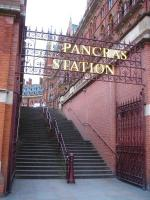 The decorative and emblazoned screen over the entrance to the steps leading up from Pancras Road in August 2014. St Pancras station and hotel stand in the background.<br><br>[David Pesterfield&nbsp;29/08/2014]