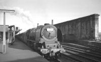 Train 1S97, a Saturday relief London Euston - Glasgow St Enoch service, stands at Carlisle platform 1 on 13 July 1963 behind Camden shed's Stanier Pacific no 46240 <I>City of Coventry</I>.<br><br>[K A Gray&nbsp;13/07/1963]