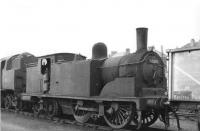 Ex-Caley 0-4-4T 55203 in the sidings alongside Corkerhill shed, thought to be in 1961. Stabled just beyond is BR standard 2-6-4 tank 80049. <br><br>[David Stewart&nbsp;//1961]