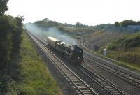 Bulleid rebuilt West Country Pacific no 34046 <I>Braunton</I> coming out of the sun past the Keypoint Railfreight Terminal on the eastern outskirts of Swindon on 19 September 2014 on its way from Bristol to Southall.<br><br>[Peter Todd&nbsp;19/09/2014]