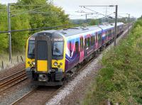 The TransPennine 14.16 from Edinburgh to Manchester Airport, formed by 350401, passing Camps Junction at speed on 9 September 2014.<br><br>[Bill Roberton&nbsp;09/09/2014]