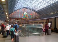 Passengers from Paris disembark at St Pancras on 5th August. The work of art under the clock bears more than a passing resemblance to the Tetris computer game.<br><br>[Ken Strachan&nbsp;05/08/2014]