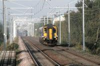 A clutter of catenary at Carmyle on 11 September as 156477 continues on its journey from Glasgow Central to Whifflet. Electrification of the route is scheduled for completion by the end of 2014.<br><br>[Colin McDonald&nbsp;11/09/2014]