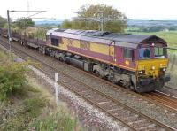 DBS 66100 with the Dalzell - Tees Yard steel empties passing the site of Camps Junction on 9 September.<br><br>[Bill Roberton&nbsp;09/09/2014]
