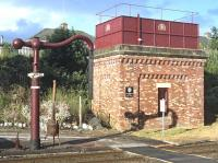 The 1991 installed water tank and column at the south end of Appleby station, bathed in sunshine on 16 July 2014.<br><br>[Bill Jamieson&nbsp;16/07/2014]