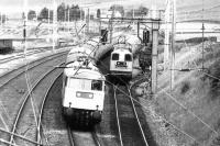An electrically hauled up express passing a pair of EE Type 1s assisting another electric locomotive on an up train standing in the loop at Abington in 1980. [See image 23276]<br><br>[Colin Miller&nbsp;//1980]