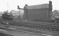 J21 0-6-0 65033 about to run past the 1891 LNER water tower at Newcastle Central on 7 May 1960. The locomotive (which pre-dates the water tower by two years) was heading for Darlington to pick up the RCTS/SDLS <I>J21 Rail Tour</I> (also referred to as the <I>Stainmore Special</I>) [see image 36091].<br><br>[K A Gray&nbsp;07/05/1960]