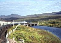 D5117 and D5120 cross the River Bran between Loch Achanalt and Loch a' Chuilinn on 13 September 1969 with the returning <I>Scottish Grand Tour No. 9.</I> The pair worked the special as far as Inverness where D5342 and D5071 took over for the final leg of the journey back to Edinburgh.<br><br>[Bill Jamieson&nbsp;13/09/1969]