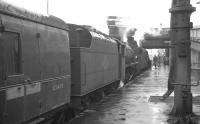 An unidentified double-headed train stands alongside platform 1 at Carlisle on a wet 30 July 1966. The locomotives are Black 5s 44833 and 45107.<br><br>[K A Gray&nbsp;30/07/1966]