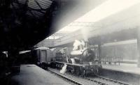 North end of Aberdeen station in the summer of 1951, with GNSR D40 4-4-0 62275 <I>Sir David Stewart</I> about to depart with a train for Macduff.<br><br>[G H Robin collection by courtesy of the Mitchell Library, Glasgow&nbsp;07/07/1951]