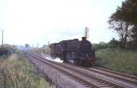 Grangemouth shed's BR standard class 5 4-6-0 no 73007 and guards van, photographed near Cumbernauld on 3 August 1965. <br><br>[G W Robin&nbsp;03/08/1965]