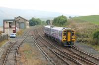 A Leeds to Carlisle service, formed by Northern 158855, slows for the Kirkby Stephen stop on 19th September 2014. The well known signal box should be here for a few more years as those on the S&C are only scheduled to close in 2027.  <br><br>[Mark Bartlett&nbsp;19/09/2014]