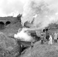 Not your typical gricers! No. 4472 <I>Flying Scotsman</I> is the centre of attention for a group of 'civilians' as it restarts from Dent on 30 September 1978 with <I>The Lord Bishop</I> to Appleby, a train it worked from Hellifield.<br><br>[Bill Jamieson 30/09/1978]