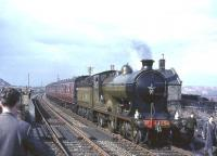 NBR 256 <I>Glen Douglas</I> with <I>Scottish Rambler no 3</I> during a photostop at Drumshoreland station on 30 March 1964. Originally opened as Broxburn in 1849 the name change occurred in 1870. The station, which closed to passengers in 1951, was located in the shale mining centre of West Lothian, signs of which can be seen on both sides of the picture. <br><br>[John Robin&nbsp;30/03/1964]