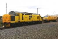 Well, there's yellow and there's yellow... The Network Rail DVT seems to have an all-over warning panel, while 97303 (formerly known as 37178) is in a lighter shade of yellow. Both were stabled just outside the depot during the Etches Park Open Day.<br><br>[Ken Strachan&nbsp;13/09/2014]