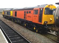 You know when you've been Tangoed: Harry Needle's bright orange 20314 [see image 36456 for a previous livery] poses next to GBRf 20901 behind Derby station on 13 September, the day of the Etches Park Open Day.<br><br>[Ken Strachan&nbsp;13/09/2014]