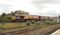 EWS 66080 passing Didcot northbound on the Oxford line on 25 September with an empty car train.<br><br>[Peter Todd 25/09/2014]