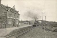 Ex-GNSR D41 4-4-0 62228 brings an up train into Mormond station on 6 July 1950.<br><br>[G H Robin collection by courtesy of the Mitchell Library, Glasgow&nbsp;06/07/1950]