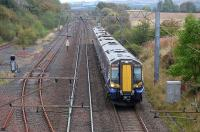 380107 passes the remains of Glengarnock yard with the 1131 Glasgow Central - Ayr on 29 September 2014. The loop here has been disconnected.<br><br>[Bill Roberton&nbsp;29/09/2014]