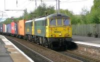 Train 4M11 Coatbridge to Daventry intermodal passing through Coatbridge Central on 4 September 2014 double headed by Freightliner locomotives 86604 + 86607.<br><br>[Ken Browne&nbsp;04/09/2014]