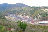 Cerbere is the last station on the French rail network before crossing the border into Spain and hosts a large complex of carriage and freight sidings to serve both standard, Spanish (1676mm) and mixed gauges.  The station is shown at the bottom right of the photograph and twin bore tunnels 1064m in length cross the border into Spain at Portbou allowing trans-border traffic of both gauges to be carried.<br><br>[Malcolm Chattwood&nbsp;23/09/2014]