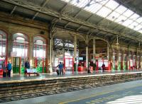 Platform scene in red and green. Preston station, 24 September 2014.<br><br>[Veronica Clibbery&nbsp;24/09/2014]