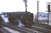 Kingmoor 9F 2-10-0 no 92110 held on the approach to Carlisle with oil tanks in October 1966.<br><br>[G W Robin&nbsp;08/10/1966]
