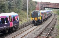 Trans Pennine EMUs meet at speed near Hest Bank on 30th September. 350409, on the left, is bound for Manchester Airport while 350405 is heading north on a service for Glasgow Central. <br><br>[Mark Bartlett&nbsp;30/09/2014]