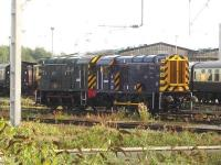 Class 08 Shunters 08507 and D3871 (08704) stabled by the Riviera Trains carriage sidings at the south end of Crewe station, with the former diesel depot visible in the background.<br><br>[David Pesterfield 30/09/2014]