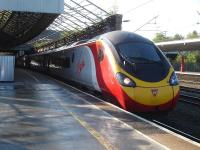Pendolino 390115 waits at platform 11 at Crewe on 30 September with the 3 minutes late 07.43 service from Euston, via Birmingham, to Glasgow Central.<br><br>[David Pesterfield&nbsp;30/09/2014]