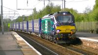 One of the recently introduced class 68s, DRS 68005, passing through Coatbridge Central on 14 September with the Inverness to Mossend Tesco Express Intermodal service.<br><br>[Ken Browne&nbsp;14/09/2014]