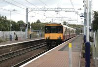 Electric Multiple Unit 318266 on a driver training run at Mount Vernon on 2 October.<br><br>[Colin McDonald&nbsp;02/10/2014]