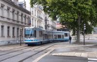 On a late Monday afternoon in July 2014, Alsthom TFS-2 tram 2032 enters  Grenoble's Place Verdun on a run south to �chirolles Denis Papin. 2032 was one of a batch of 15 delivered in 1989/90, and is one of 53 of the type running in the city.<br><br>[Andrew Wilson&nbsp;07/07/2014]