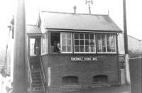A smile from the signalman at Abermule on 6 August 1960. A tragic 'misunderstanding' between staff at this station some 39 years earlier led to a single line head-on collision resulting in 17 fatalities. [Ref query 8091]<br><br>[David Stewart&nbsp;06/08/1960]
