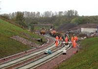 The Dutch track-laying train inches steadily southwards from Newcraighall on 6 October 2014 [see image 48935] propelled by a GB Railfreight Class 66 .... just 30 miles to go!<br><br>[David Spaven&nbsp;06/10/2014]
