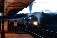 The sun has gone down at Hellifield on 4 October as 46115 <I>Scots Guardsman</I> waits in the shadows with the return <I>Lune Rivers Trust</I> charter as it takes on water.<br><br>[John McIntyre&nbsp;04/10/2014]
