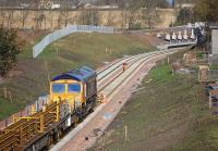 GBRf 66736 continuing tracklaying on the up line to the south of Shawfair Station on 7 October 2014.<br><br>[Bill Roberton&nbsp;07/10/2014]